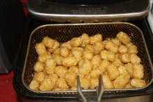 I deep fried my tater tots because it was quicker. You can bake them if you want to.