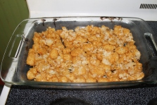 Take the cooked tater tots and line them in a baking dish. I actually pushed the tots down to make a crust-like base